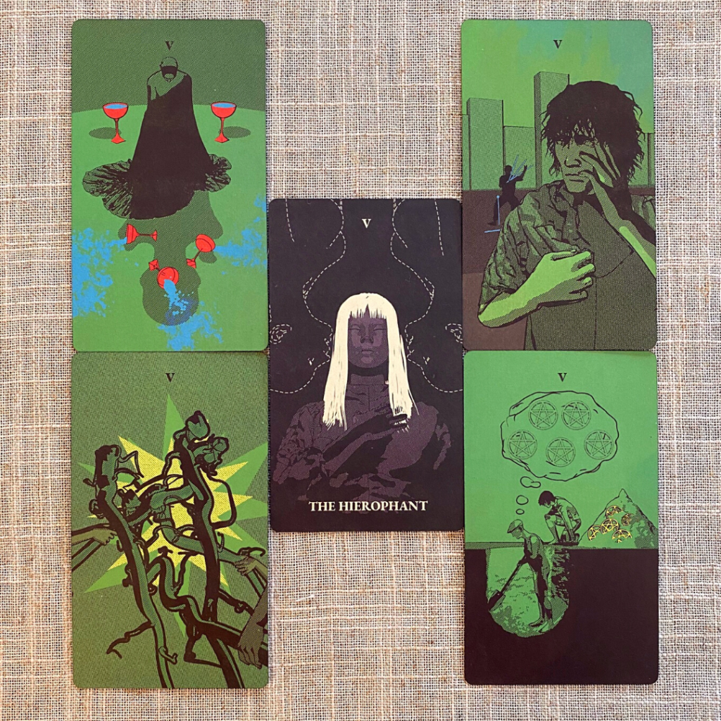 The Hierophant surrounded by the other five cards from the Tarot of the Holy Spectrum deck. The Hierophant card depicts two ghostly figures whispering into the ears of the androgynous Hierophant.